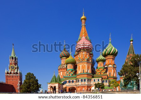 Intercession Cathedral  and the Spassky Tower of Moscow Kremlin at Red Square in Moscow. Russia - stock photo