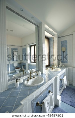 interior of a bathroom in blue color - stock photo