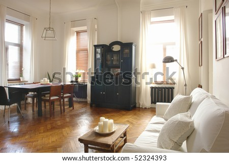 interior of a living room and dinning room - stock photo