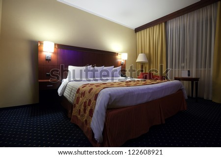 interior of bedroom with double bed - stock photo