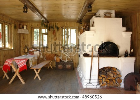 Interior of russian house with traditional oven - stock photo