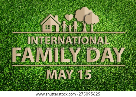 International Family day concept. Paper cut of family on green grass. - stock photo