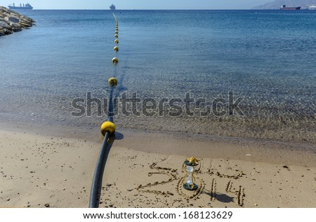 2014 is coming to the sandy beach of Eilat - famous Israeli resort and recreation city - stock photo