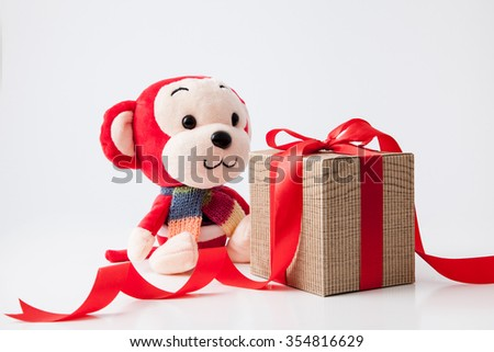 2016 is year of the monkey decorate with gift box and red ribbon for chinese new year - stock photo