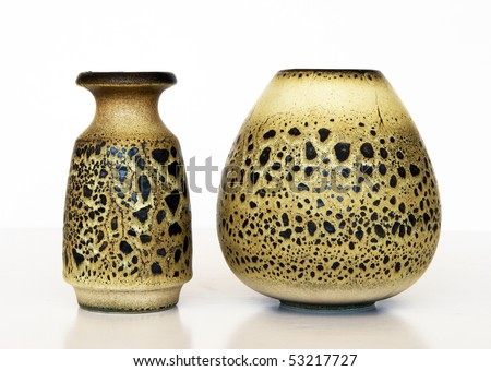 Israeli  ceramic pair: two vases of the different form. Style of 1950-th years. Sandy color; black spots on a surface.Symbolizes couple: He and She; a bride and a groom etc. Isolated on white.