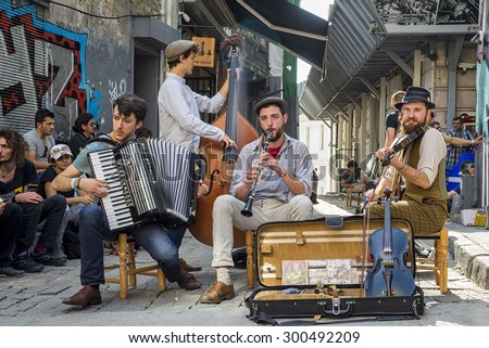 Istanbul, Turkey - 15/06/2014: street musicians are present in a lot of streets of Istanbul and tourists are accompained by theyr music douring the visit of the city - stock photo