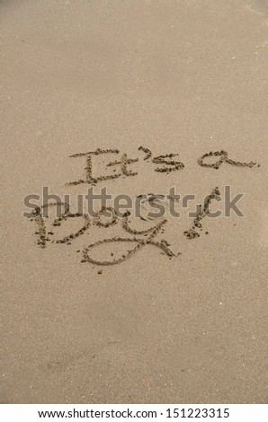 """It's a boy,"" a message written in the sand."