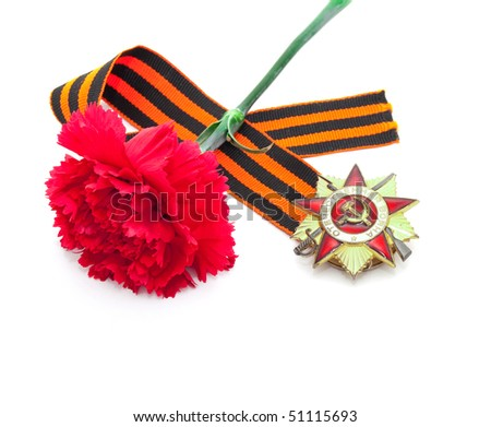 It's the ribbon of Saint George and carnation. Symbols of Russian Victory Day of Second World war.