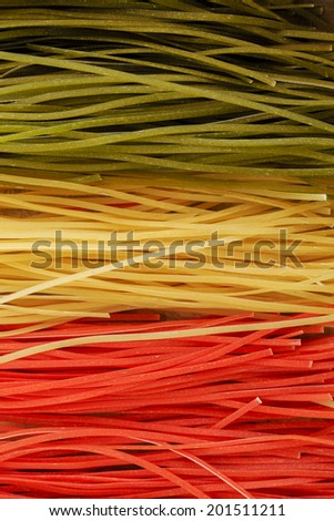 Italian cuisine - Italian tricolor pasta - stock photo