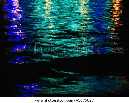 Ð¡ity light reflection on the river wave. May be used as background. - stock photo