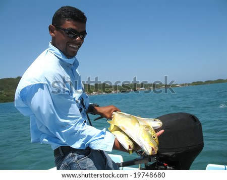 3 jacks caught by a fishing guide in Honduras - stock photo