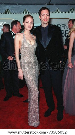 "24JAN99:  Actress ANGELINA JOLIE & brother at the Golden Globe Awards in Beverly Hills.  She won Best Actress in a TV mini-series or Movie for ""Gia"".  Paul Smith/Featureflash - stock photo"