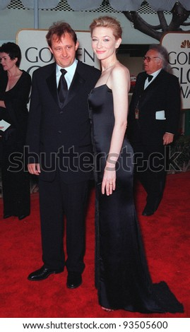 "24JAN99:  Actress CATE BLANCHETT & boyfriend (?) at the Golden Globe Awards in Beverly Hills. She won Best Actress in a Movie (Drama) for ""Elizabeth"".  Paul Smith/Featureflash"
