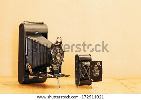 "20 JANUARY 2014 - ENGLAND - Vintage Kodak No 3A Folding Pocket camera, 1903 to 1915; and Eastman Kodak Vest Pocket Autographic Special folding camera, 1916 to 1923, known as the ""soldiers' camera"""