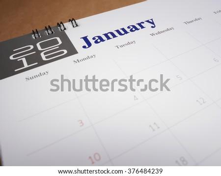 2016 January on calendar page, desk calendar - stock photo