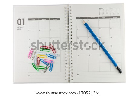 2014 January organizer with pencil & clips. - stock photo