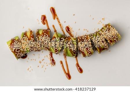 Japanese cuisine, sushi on white background. Sushi roll with salmon and shrimp tempura. Sushi Set and sushi rolls served on stone slate. - stock photo