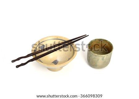 Japanese rice bowl with chopsticks and tea cups