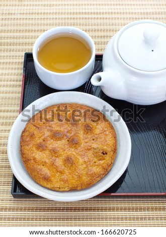 japanese rice crackers , soy sauce flavor with japanese tea - stock photo