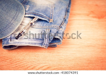jeans pocket with e-cigarette, on the background