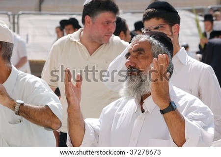 JERUSALEM - OCTOBER 9: Jews in prayer at the Western Wall during Jewish holiday of Sukkot October 9, 2006 in Jerusalem, Israel. Sukkot is one of the Jews three major holidays.