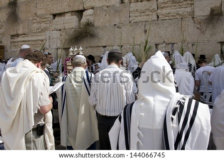 JERUSALEM-OCTOBER 02: The Jews  at the Western Wall during Jewish holiday of Sukkot, October 2, 2012 in Jerusalem, Israel. - stock photo
