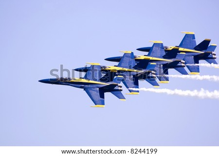 4 jet fighters in formation at an airshow