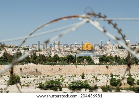 jewish conflicts in Jerusalem. Rock Dome on the Temple Mount in Jerusalem in Israel with behind wired fence - stock photo