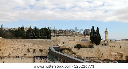 Jewish worshipers pray at the Wailing Wall an important jewish religious site . Jerusalem, Israel - stock photo