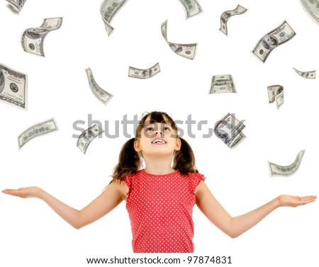 joyful beautiful little girl , with ; bulk cash dollars, on white background, isolated - stock photo
