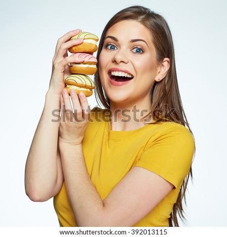 Joyful woman holding pile of cake macaron. Isolated face portrait of girl with sweets. - stock photo