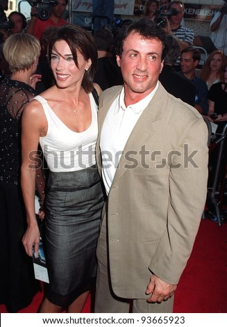 "01JUL97:  SYLVESTER STALLONE & wife JENNIFER FLAVIN at the premiere of ""Contact,"" which stars Jodie Foster & Matthew McConaughey."