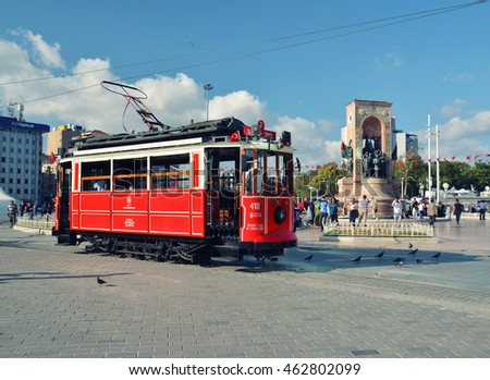 26 July 2016, Istanbul - TURKEY: Old red tram goes on Istiklal street in Istanbul, popular touristic transport