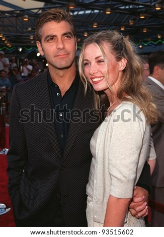 "17JUN98:  Actor GEORGE CLOONEY & girlfriend CELINE BALITRAN at premiere of his new movie ""Out of Sight,"" at Universal Studios, Hollywood."