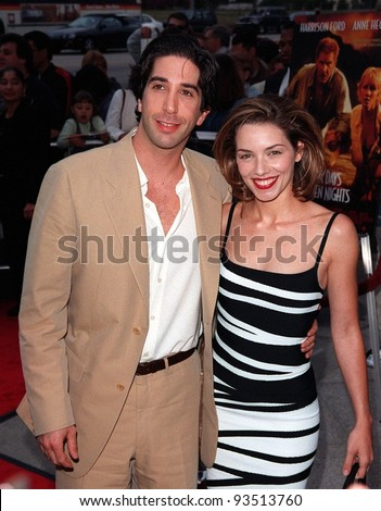 "08JUN98:  ""Friends"" star DAVID SCHWIMMER & girlfriend actress MILI AVITAL at premiere of his new movie, ""Six Days, Seven Nights,"" in which  he stars with Harrison Ford & Anne Heche."