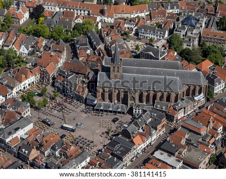 4 June 2015 Amersfoort, Netherlands. Aerial view of the old church SINT JORISKERK the square of an ancient city. On the square there are tables and chairs from all the restaurants around the church.
