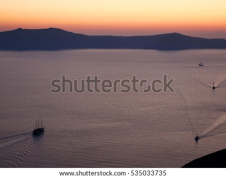 11 june 2013 greece santorini. tourists are waching sunset and swimming  in a populae island santorini.