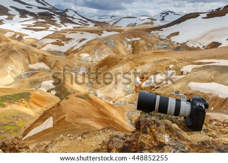 22 June 2016 Iceland, a canon camera with a telelens attached to it on top of a hill at  Kerlingarfjoll or The Ogress' Mountains, a volcanic mountain range situated in the highlands of Iceland. - stock photo