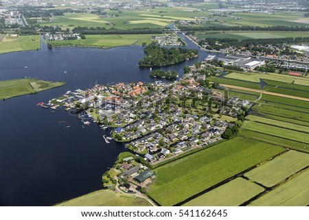 9 June 2016, Kaag, Holland. Aerial view  of the village Kaag. Kaag is a small island in Lake Kager plas surrounded by green fields. In the center of the town the Feadship shipyard of Royal van Lent.
