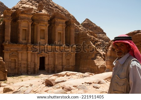 9 June 2014, Petra, Jordan: A local vendor outside the Monastery, one of the famous monuments of the ancient Nabatean city of Petra, Jordan. - stock photo