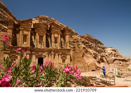 8 June 2014: Tourists om front of the facade of the Monastery, one of the famous monuments of the ancient Nabatean city of Petra, Jordan. - stock photo