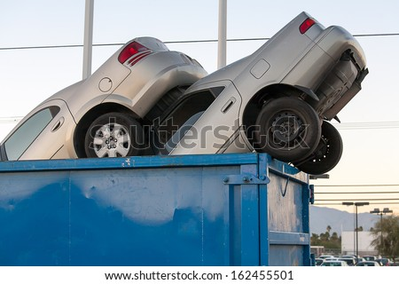 2 junk cars in a dumpster - stock photo