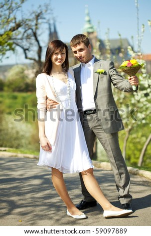 just married in a flowering garden - stock photo