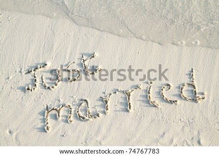 'Just Married' written in sand. - stock photo