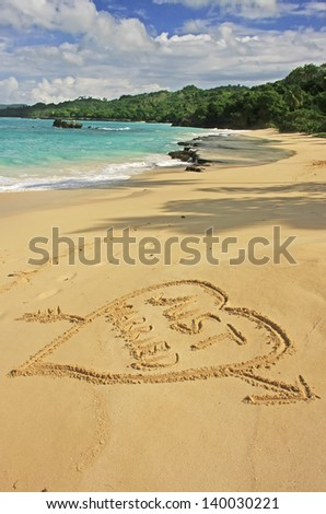 """Just married"" written in sand on a beach - stock photo"