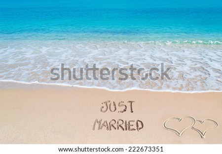 """just married"" written on a tropical beach - stock photo"