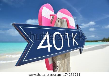 401k arrow on the beach - stock photo