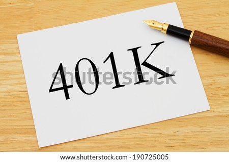 401K Planning, A white card with text of  401K and a fountain pen on a wooden desk - stock photo