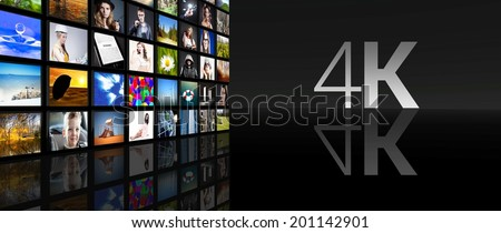 4K Television screens on black background - stock photo