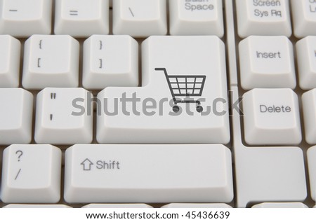 Keyboard with shopping cart symbol on a button - stock photo